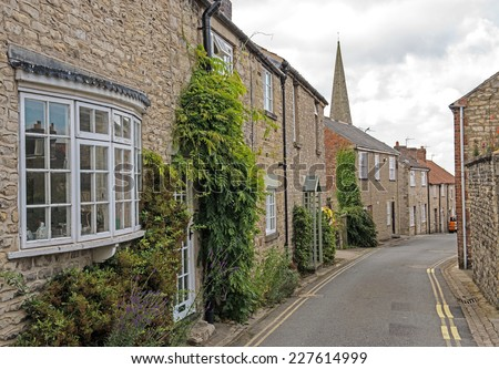Narrow lane in the old market town of Pickering in North Yorkshire, England - stock photo