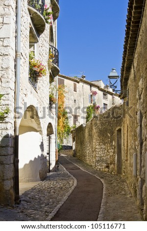 Narrow medieval street. Famous village of Saint-Paul-de-Vence is a commune in the Alps-Maritimes department in southeastern France - one of the oldest medieval towns on the French Riviera.