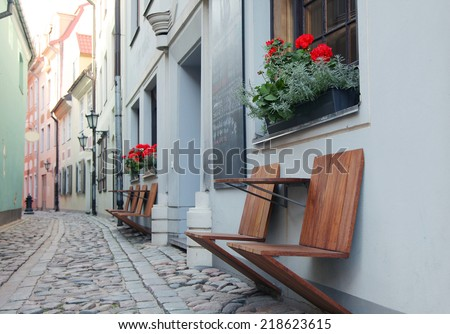 Narrow medieval street in old city of Riga, Latvia. In 2014, Riga is the European capital of culture - stock photo