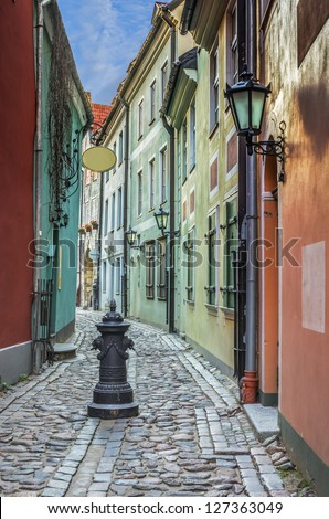 Narrow medieval street in old Riga cit, Latvia. In 2014, Riga is the European capital of culture - stock photo