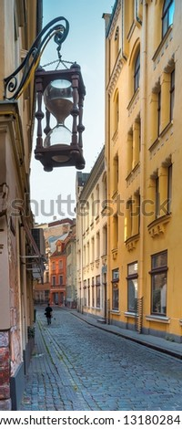 Narrow medieval street in the old Riga city, Latvia, Europe - stock photo