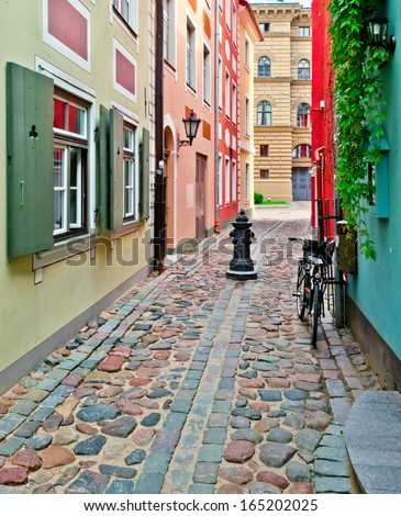 Narrow medieval street in the old Riga city, Latvia. In 2014, Riga is the European capital of culture - stock photo