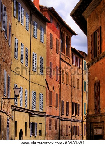 Narrow medieval street in the Tuscan city of Siena, Italy