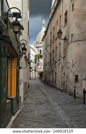 Narrow medieval street near Montmartre, Paris, France - stock photo