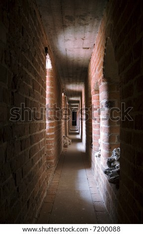 Narrow oblong gallery in the Malbork castle, Poland - stock photo