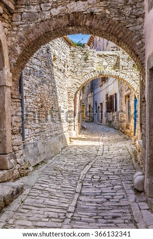 Narrow Old Street And Buildings Made Of Stone - Bale, Istria, Croatia, Europe - stock photo