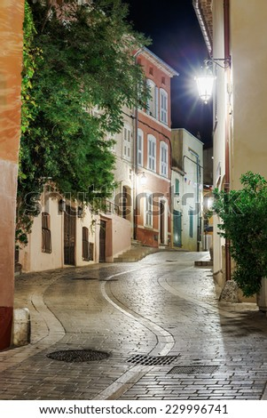Narrow old street at night in Saint-Tropez, France. - stock photo