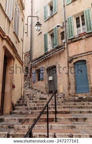 Narrow old street in the old town Cannes, France - stock photo
