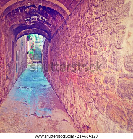 Narrow Old Tunnel in Italian City of Volterra, Instagram Effect - stock photo