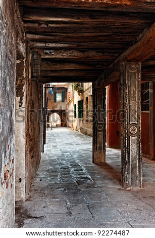 Narrow passage between buildings in Venice,Italy. - stock photo