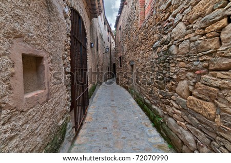 Narrow passageway between two walls in Peratallada, Spain - stock photo