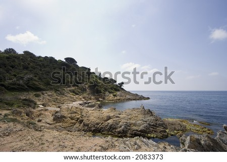 narrow path between the cliffs on the mediterranean sea - gulf of saint-tropez, french riviera - stock photo
