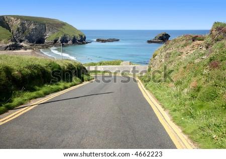 Narrow steep road to Portreath, Cornwall, UK. - stock photo