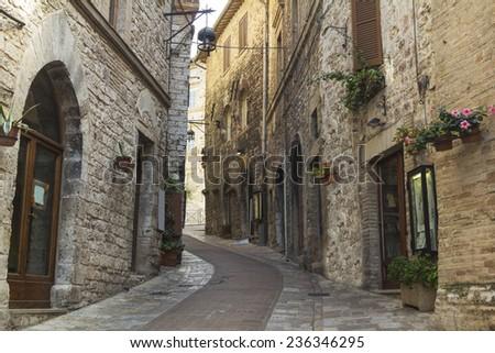 Narrow stone street in Tuscany - stock photo