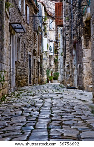 Narrow stone street of Trogir; Croatia - stock photo