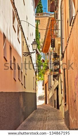 Narrow street - stock photo