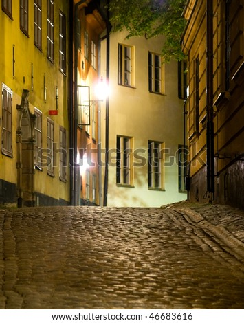 Narrow street at night in the old town (Gamla Stan) of Stockholm, sweden - stock photo