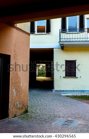 Narrow street between italian houses in old town , Toning. - stock photo