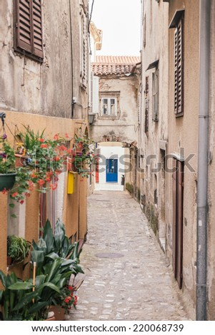 Narrow street in city of Krk  - stock photo