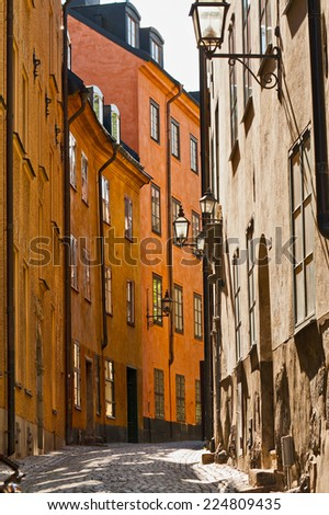 Narrow Street in Gamla Stan, Stockholm, Sweden - stock photo