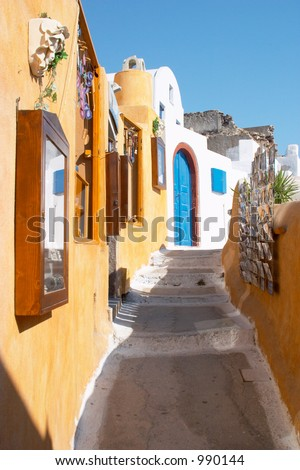 Narrow street in Oia Santorini Greece - stock photo