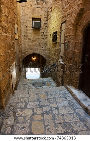 Narrow street in Old Jaffa which is one of the most ancient port cities in the world - stock photo