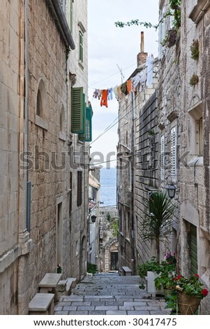 Narrow street in old medieval town Korcula  by night. Croatia, Dalmatia region, Europe. - stock photo