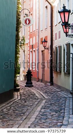 Narrow street in old Riga city, Latvia. In 2014, Riga is the European capital of culture - stock photo