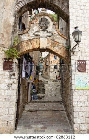 Narrow street in old UNESCO town of Kotor, Montenegro. - stock photo