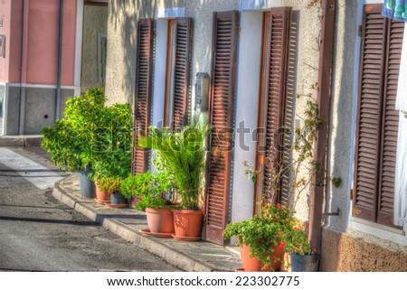 narrow street in Stintino in hdr tone - stock photo