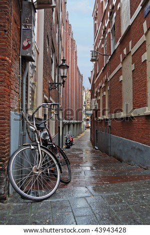 Narrow street in the Amsterdam center on a rainy day - stock photo