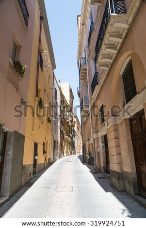 Narrow street in the city center of Cagliari, Italy.