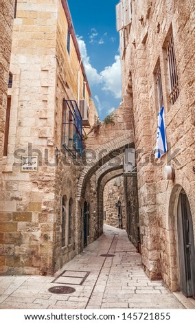 Narrow street in the OLd City of Jerusalem - stock photo