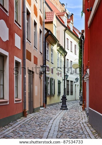 Narrow street in the old city of Riga, Latvia. In 2014, Riga is the European capital of culture - stock photo
