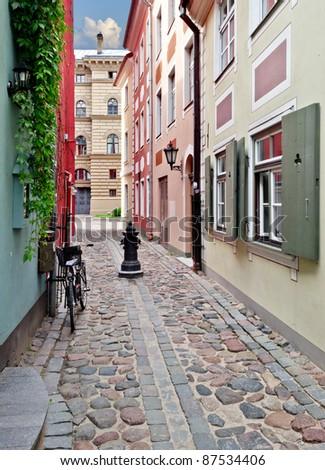 Narrow street in the old Riga city, Latvia. In 2014, Riga is the European capital of culture - stock photo