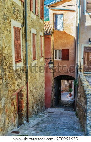 Narrow street in the old town Coaraze in France - stock photo