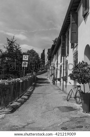 Narrow street in the old town in Italy . Black and white photography. - stock photo