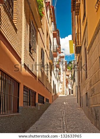 Narrow street in the old town of Granada, Spain - stock photo