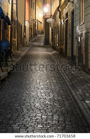 Narrow street in the old town of Stockholm at night - stock photo