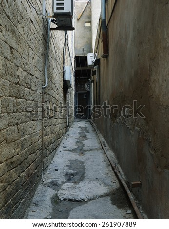 Narrow street in the old town of the city - stock photo