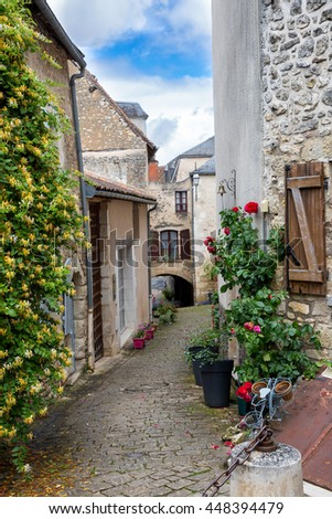 Narrow street in the village of Angles-sur-lâ??Anglin, France