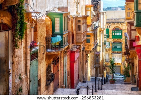 Narrow street in Valletta - the capital of Malta. - stock photo