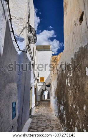 Narrow street of ancient Medina in Hammamet, Tunisia, Mediterranean Sea, Africa, HDR - stock photo