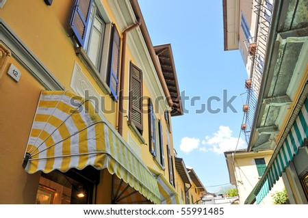 Narrow street of Bellagio town at Como lake - stock photo