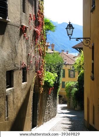 Narrow street of Menaggio, Italy - stock photo