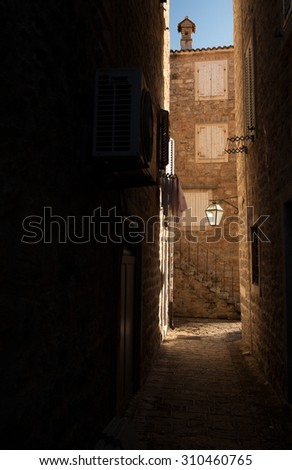 Narrow street of old Kotor, Adriatic coast, Montenegro, beautiful world - stock photo