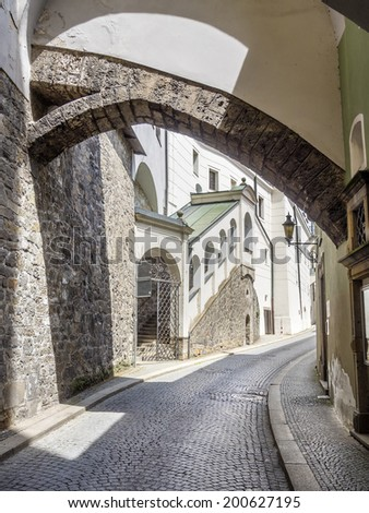 Narrow street Passau, Germany, a street with cobblestones in Summer. - stock photo