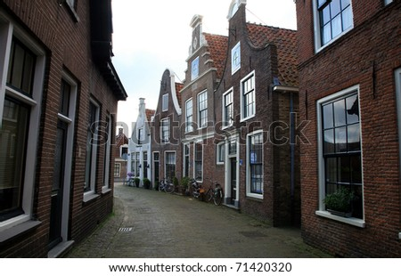 Narrow street - path in small town Blokzijl in Netherlands, - stock photo