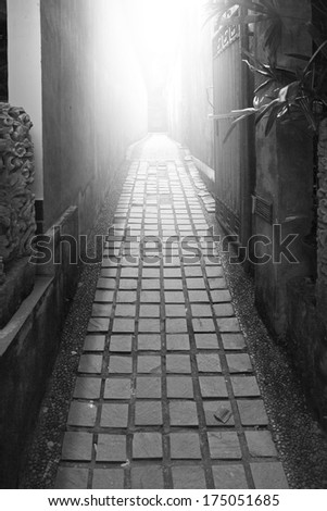 Narrow street perspective view monochrome  - stock photo