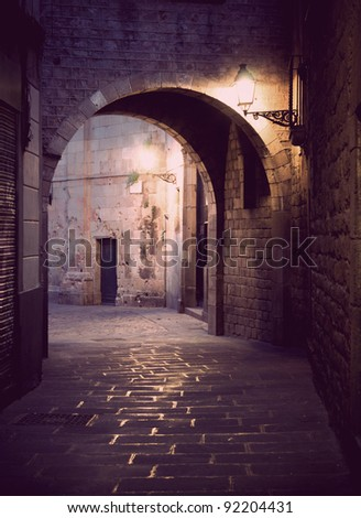 Narrow street with archway in the Old Town of Barcelona, Spain. - stock photo